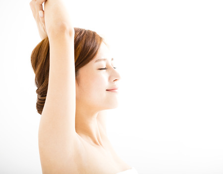 girl care: beautiful smiling Young woman with clean armpit Stock Photo