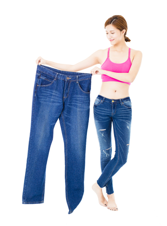 slim: happy beautiful slim young woman with big jeans
