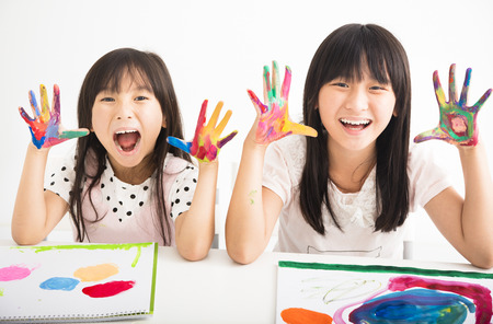 elementary: happy little girls with hands in the paint Stock Photo