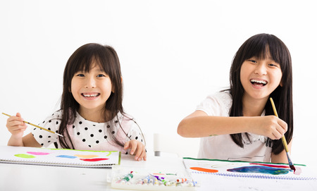 asian art: happy children painting in the classroom Stock Photo