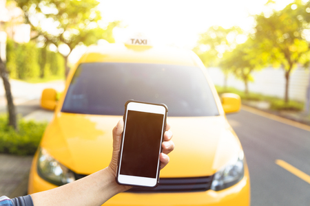 yellow taxi: Man orders a taxi from his cell phone