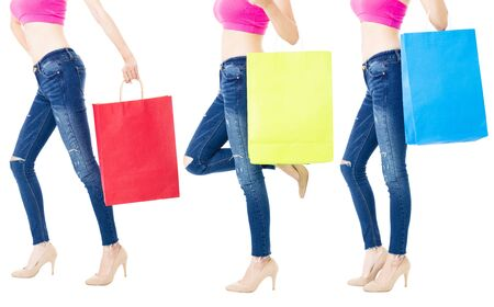 women in jeans: Legs of shoppers with shopping bags