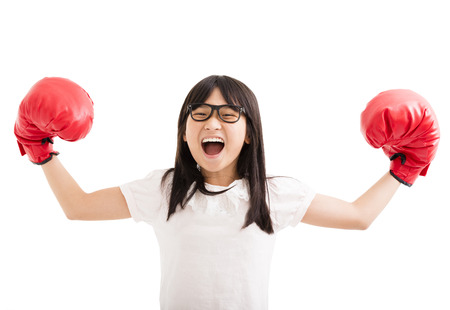 girl punch: happy little girl with red boxing gloves Stock Photo