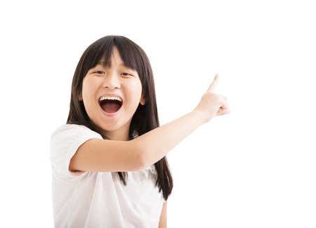 kids hand: happy little girl with pointing finger Stock Photo