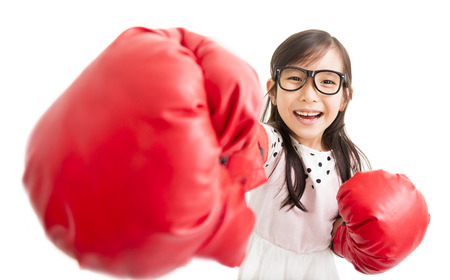 female boxing: happy little girl with red boxing gloves Stock Photo