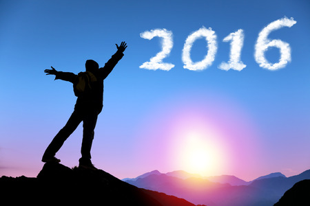 happy new year 2016.man on top of the mountain looking the cloud photo