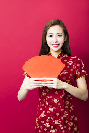 happy chinese new year.young woman with red envelope