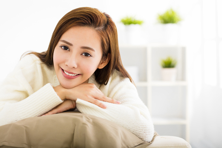 asian lady: Young beautiful woman relaxing on sofa
