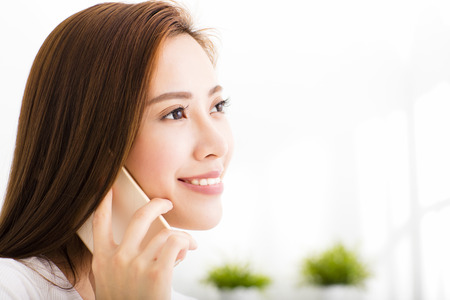 woman at the phone: young beautiful woman talking on the phone Stock Photo