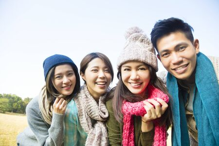 wear: happy young group with winter wear