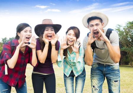 happy young group with shouting gesture 스톡 콘텐츠