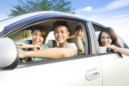 student travel: happy young group having fun in the car