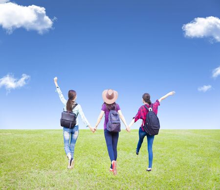 three girls: three girls enjoy vacation and tourism with cloud background