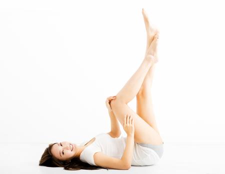female legs: beautiful young woman showing long legs