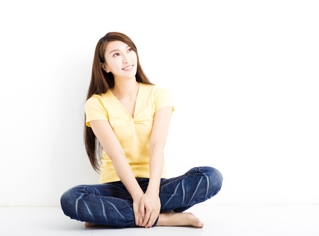 sitting on floor: happy young woman sitting on the floor