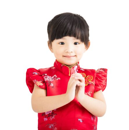 child smile: happy chinese new year.little girl with congratulation gesture