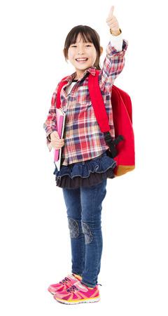 MOCHILA: longitud total de niña sonriente con el pulgar arriba Foto de archivo