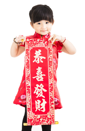chinese dress: happy little girl showing Spring festival couplets for chinese new year Stock Photo