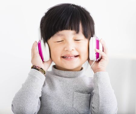 happy little Girl with Headphones Listen Music