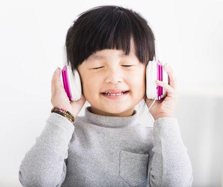 happy little Girl with Headphones Listen Music