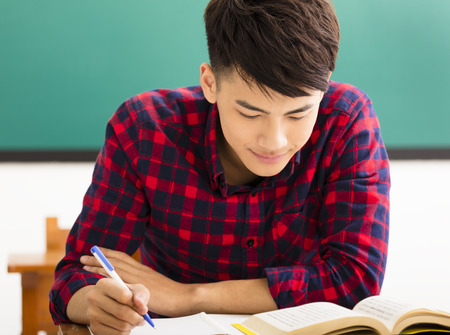 male college student study in university classroom Stockfoto