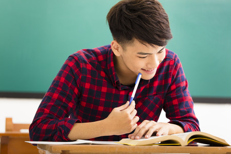 young student: male college student study in university classroom Stock Photo