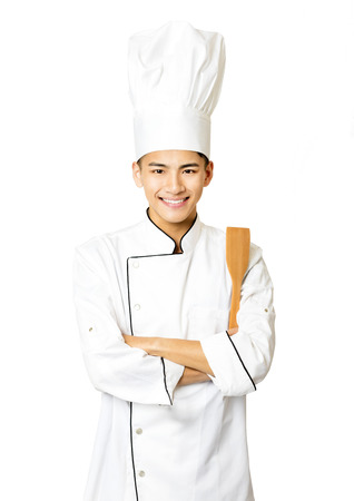 asian cook: Portrait of young  male chef isolated on white