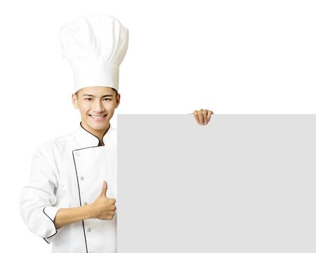 professional people: young chef with thumb up and showing  empty board