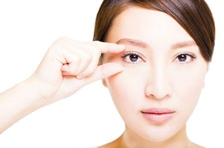 women face stare: Closeup shot of young smiling woman eyes makeup