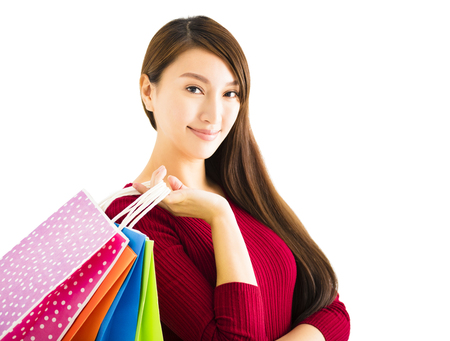 hold on: smiling young woman with shopping bags Stock Photo