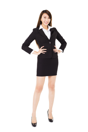 business woman standing: young smiling business woman isolated on white
