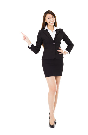 woman pointing: young smiling business woman with pointing gesture Stock Photo