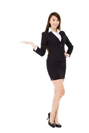 asian businesswoman: young smiling business woman with showing gesture