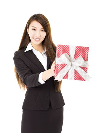 gift giving: young smiling businesswoman  showing the gift box