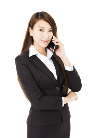 business woman phone: young business woman talking on the phone