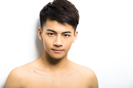 shave: Closeup portrait of attractive young man face Stock Photo