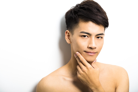 boy beautiful: Closeup portrait of attractive young man face Stock Photo