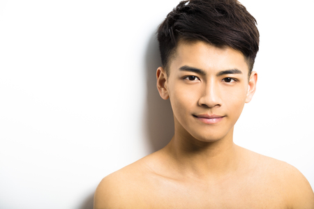 beautiful boys: Closeup portrait of attractive young man face Stock Photo