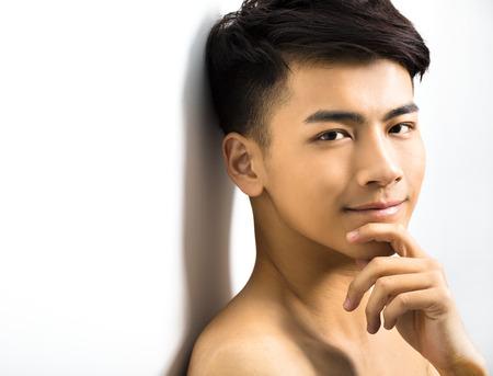 Closeup portrait of attractive young man face Stock fotó