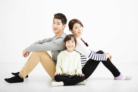 family isolated: happy asian family sitting together