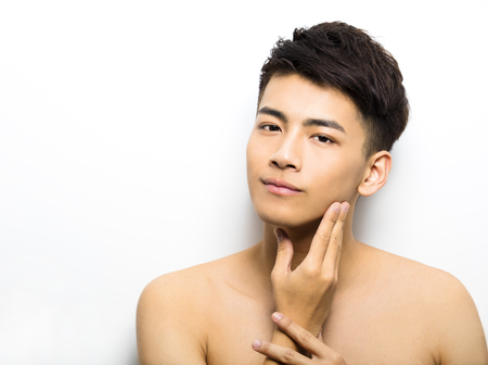 fashion boy: Closeup portrait of attractive young man face Stock Photo