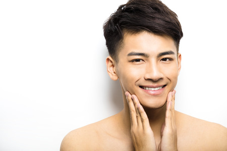charming: Closeup portrait of attractive young man face Stock Photo