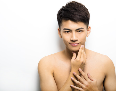boy body: Closeup portrait of attractive young man face Stock Photo