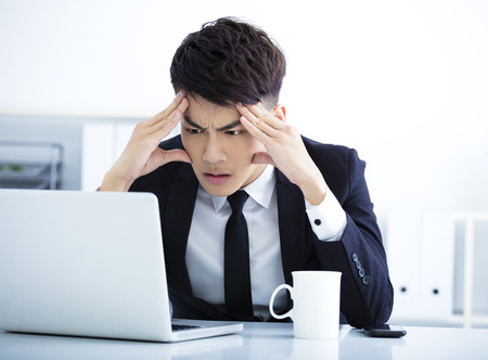 exhausted worker: Businessman having stress in the office