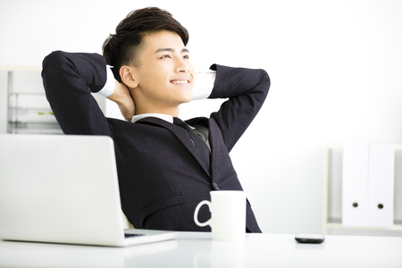 happy young  businessman relaxing in office Stock Photo