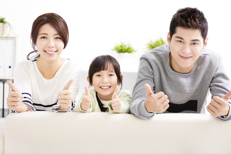 happy girls: Happy Attractive Young  Family with thumbs up Stock Photo