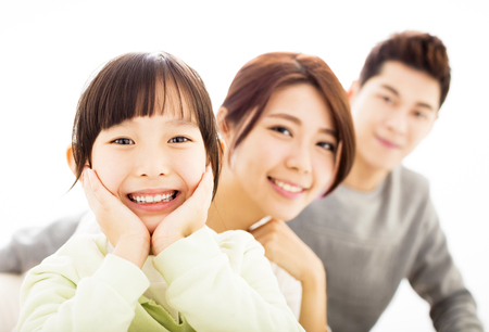 family asia: Happy Attractive Young  Family Portrait