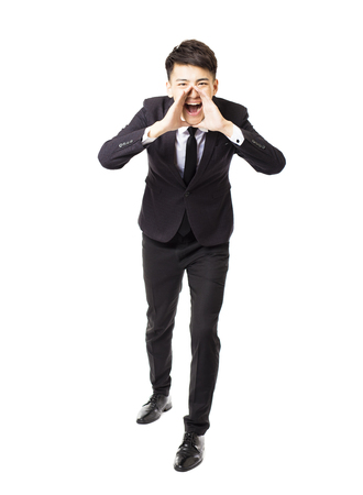 asian guy: young business man shouting and isolated on white