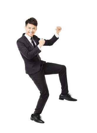happy workers: happy  young business man with successful gesture