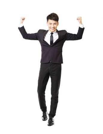 white suit: happy  young business man with successful gesture